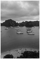 Elevated view of beach, boats and karst from Titov Island. Halong Bay, Vietnam (black and white)