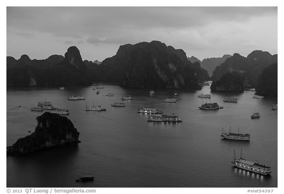 Moored boats and islands from above at dusk. Halong Bay, Vietnam (black and white)