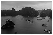 Moored boats and islands from above at dusk. Halong Bay, Vietnam ( black and white)