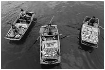 Women selling sea shells and perls from row boats. Halong Bay, Vietnam ( black and white)