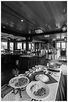 Pho buffet in tour boat dining room. Halong Bay, Vietnam ( black and white)
