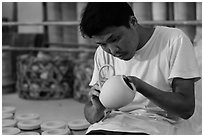 Man assembling ceramic tea pot in workshop. Bat Trang, Vietnam (black and white)