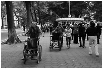 Elderly women pushing their wheelchairs while walking for exercise. Hanoi, Vietnam (black and white)