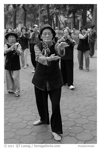 Elderly women practising Tai Chi. Hanoi, Vietnam (black and white)