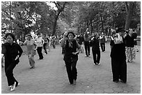 Group of women practising Tai Chi on Hoang Kiem lakeshore. Hanoi, Vietnam (black and white)