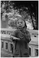 Elderly woman doing Tai Chi moves. Hanoi, Vietnam (black and white)