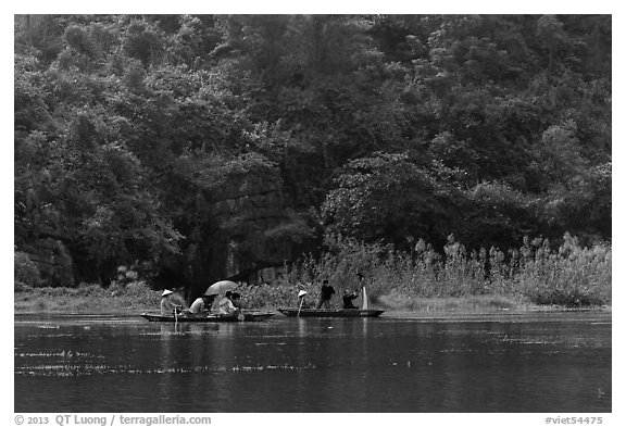 Distant wedding party, Trang An. Ninh Binh,  Vietnam (black and white)