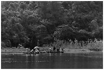 Distant wedding party, Trang An. Ninh Binh,  Vietnam ( black and white)