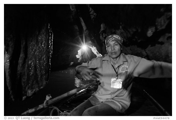 Woman boater in narrow cave passage, Trang An. Ninh Binh,  Vietnam (black and white)