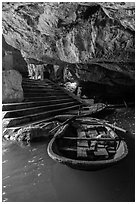 Boats moored inside cave, Trang An. Ninh Binh,  Vietnam (black and white)