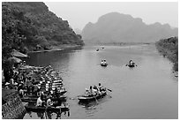 Groups leaving wharf on boats, Trang An. Ninh Binh,  Vietnam (black and white)