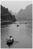 Boats in karstic lanscape of steep cliffs, Trang An. Ninh Binh,  Vietnam (black and white)
