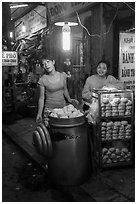 Dumpling vendors at night, old quarter. Hanoi, Vietnam ( black and white)