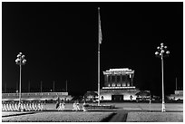 Guards marching in front of Ho Chi Minh Mausoleum at night. Hanoi, Vietnam ( black and white)