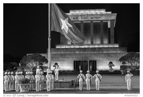 Lowering of flag in front of Ho Chi Minh Mausoleum at night. Hanoi, Vietnam (black and white)