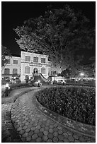 Public garden and library building at night. Hanoi, Vietnam (black and white)