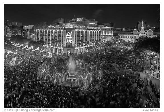 New year eve, city hall plaza with crowds. Ho Chi Minh City, Vietnam (black and white)