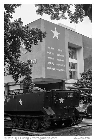 Tanks and signs extolling peace, War Remnants Museum, district 3. Ho Chi Minh City, Vietnam (black and white)