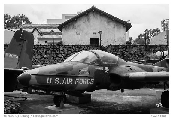 Warplane and wall with barbed wire, War Remnants Museum, district 3. Ho Chi Minh City, Vietnam (black and white)