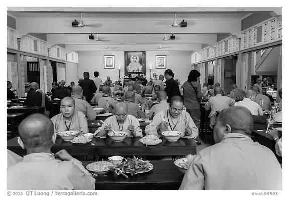 Monks and nuns having diner, An Quang Pagoda, district 10. Ho Chi Minh City, Vietnam (black and white)