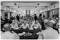 Monks and nuns having diner, An Quang Pagoda, district 10. Ho Chi Minh City, Vietnam ( black and white)