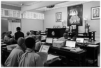 Monks working on computers, An Quang Pagoda, district 10. Ho Chi Minh City, Vietnam ( black and white)
