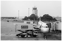 Airliner and control tower, Tan Son Nhat airport, Tan Binh district. Ho Chi Minh City, Vietnam ( black and white)