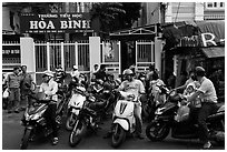 Parents waiting to pick up children in front of school. Ho Chi Minh City, Vietnam (black and white)
