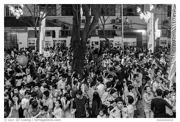 Street with Christmas eve crowds. Ho Chi Minh City, Vietnam (black and white)