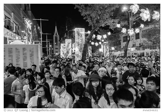 Street filled with crowds on Christmas eve. Ho Chi Minh City, Vietnam (black and white)
