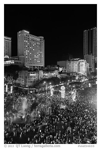 Packed Nguyen Hue boulevard on Christmas eve from above. Ho Chi Minh City, Vietnam (black and white)