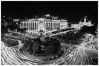 Traffic circle with light trails, Rex Hotel and City Hall. Ho Chi Minh City, Vietnam (black and white)