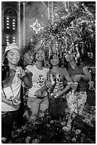 Young Revellers in front of Notre Dame Cathedral on Christmas Eve. Ho Chi Minh City, Vietnam (black and white)