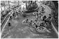 Lazy river ride, Dam Sen Water Park, district 11. Ho Chi Minh City, Vietnam (black and white)