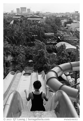 Woman on tall water slide, Dam Sen Water Park, district 11. Ho Chi Minh City, Vietnam (black and white)
