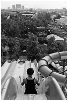 Woman on tall water slide, Dam Sen Water Park, district 11. Ho Chi Minh City, Vietnam ( black and white)