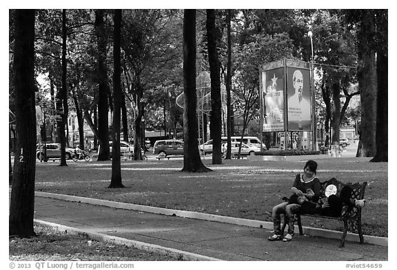 Relaxing on a public bench in April 30 Park. Ho Chi Minh City, Vietnam (black and white)