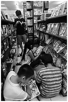 Children reading in bookstore. Ho Chi Minh City, Vietnam (black and white)