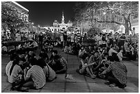 Groups in front of City Hall on New Year eve. Ho Chi Minh City, Vietnam (black and white)