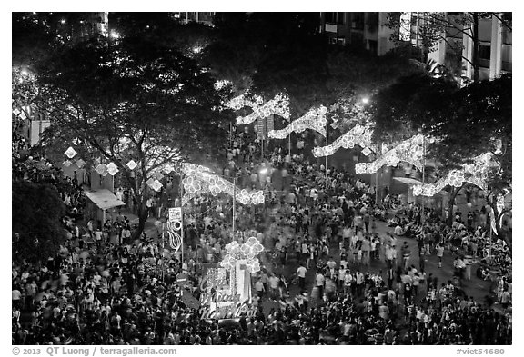 Le Loi boulevard with decorations and crowds from above. Ho Chi Minh City, Vietnam (black and white)