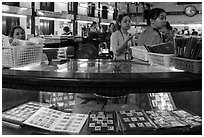 Stamp vending booth in central post office. Ho Chi Minh City, Vietnam (black and white)