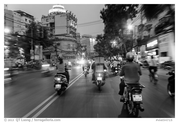 View from middle of street traffic at dusk. Ho Chi Minh City, Vietnam (black and white)