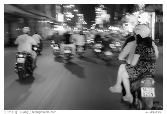 Riders view of motorcycle traffic blurred by speed. Ho Chi Minh City, Vietnam (black and white)