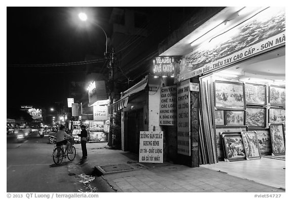 Stores selling pictures at night. Ho Chi Minh City, Vietnam (black and white)