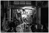 Frame shop at night. Ho Chi Minh City, Vietnam (black and white)