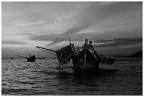 Man on fishing boat at sunset. Mui Ne, Vietnam (black and white)