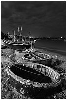 Coracle boats at night. Mui Ne, Vietnam (black and white)