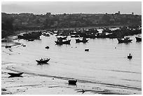 Fishing fleet and village at dawn. Mui Ne, Vietnam (black and white)
