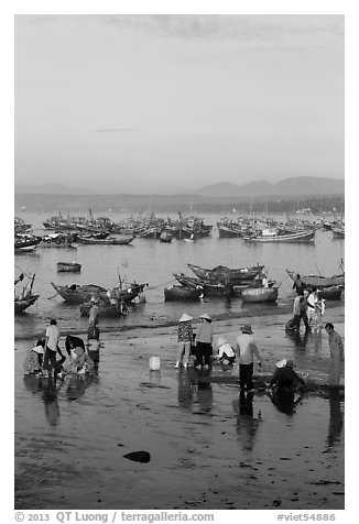 Miror-like beach and fishing boats, early morning. Mui Ne, Vietnam (black and white)