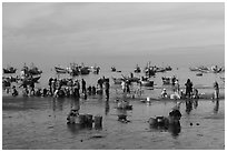 Fishermen, vendors, and boats. Mui Ne, Vietnam (black and white)